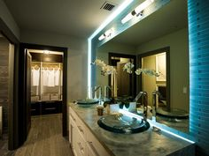 A vanity backlight adds ambient mood lighting and showcases tile-clad walls.