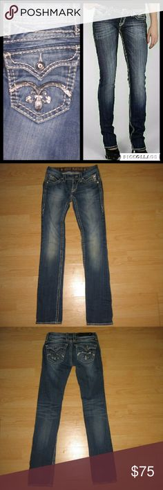 "Rock Revival Sasha Straight Leg Jeans These jeans are preloved but still in very good condition. They are the Sasha T16 straight leg jean. Features blingy sequins on the pockets and rhinestone/crystal rivets. Made of 98% cotton 2% elastane. Tag size is 25.  Waist across with natural dip is 13"" Waist across when aligned is 13.5"" Front Rise is 6"" Inseam is 32"" Rock Revival Jeans Straight Leg"
