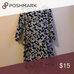 Floral Dress Black and white floral dress. Deep front pockets. Three quarter sleeve. Button closure on back. Falls above knee. Great condition! Smoke free pet free home. Forever 21 Dresses