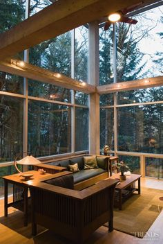 The combination of the sloping site and the double-height ceiling in the living room makes the view of the tall fir trees from this room particularly impressive.