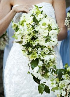 fresh creams and greens maintain their classic appeal when brought together in a cascading bouquet like this one