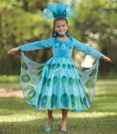 peacock princess costume - of all the birds in the world, your regal peacock might be the most beautiful. you dazzle in this blue and green frock with iridescent organza overlay and attached cape. distinctive peacock designs adorn the dress and headpiece (which is included), and when you raise your arms, the cape fans out like a peacock's tail!
