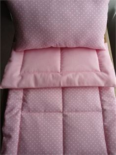 2 Piece Pink with White DotsDoll Bedding Set   Blanket Pillow   Blanket Measures: 24 1/2 x 14 1/2   Pillow Measures: 6 x 12   This two piece Doll Bedding Set features a Pink cotton fabric withWhite Dots. On the back is a solid Pink cotton fabric.   In the center of the blanket is Polyester Batting then I machine stitch all three layers together using a Block Style Pattern with 1 1/2 Borders.   The Pillow is stuffed with Non-Allergenic Premium Polyester Fiberfill.   Cotton   Machine Wash…