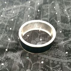 RESERVED.  Black and Silver Tone Bangle Bracelet This spectacular cuff bracelet is new without tags.  The glossy black finish looks like lacquer.  It is a stunner. Jewelry Bracelets