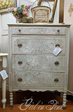 Girl in Pink..... I mixed Pure White and French Linen for the body of the dresser, then used Old White and French Linen along with my favorite Floral Scroll stencil from Artisan Enhancements to create the design on the drawers. After a light distressing and a coat of clear wax, I applied dark wax in all of the corners and long the edges. Available now at Camas Antiques