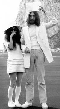 I love this iconic picture of Yoko Ono and John Lennon on their wedding day. White knee socks, a sun hat and a mini skirt isn't the most conventional bridal dress, but Yoko looks perfect just as she is.
