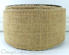 """Silver metallic threads woven with natural burlap give a subtle sparkle to the primitive look of burlap!. 2 1/2"""" wide, with a wired edge by Offray Lion Ribbon. Available from the Cottage Crafts Shop on Etsy."""