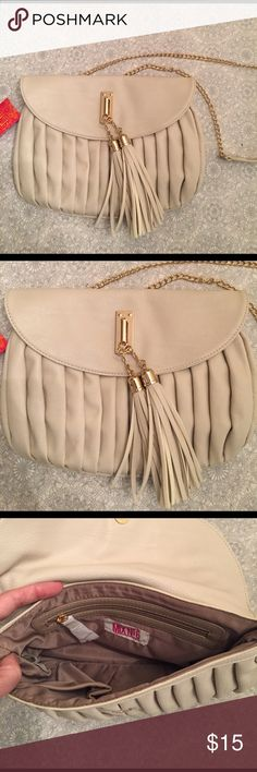Purse with tassel NWT cream colored purse with chain strap and tassel accents. mix no 6 Bags Crossbody Bags