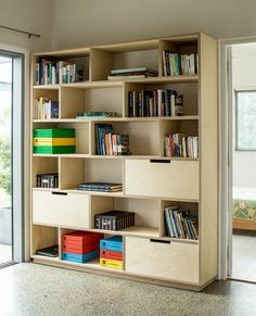 A great example of how to combine office storage and a bookshelf for the home office. Large soft close drawers hide away all the bits and provide ample storage