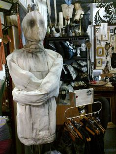 Victorian straight jacket and mask .