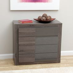 This Maya chest of drawers features a modern rectangular design along with a neutral walnut finish. The rubber wood and MDF piece contains four drawers for convenient organization.