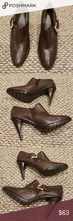 Michael Kors brown ankle boots sz 9M Good preowned condition. Buckle accent. High heel. Please enlarge pictures for condition of this item. Thanks. Michael Kors Shoes Ankle Boots & Booties