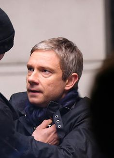 """Now please look at the scarf. Considering the light, and time, it' a lot similar to Sherlock's scarf from second season. Also, John in the two series NEVER wore scarves! IS JOHN REALY WEARING SHERLOCKS SCARF?  HE THINKS HES WEARING HIS DEAD BEST FRIENDS SCARF.... :""""( *actual sobbing*"""