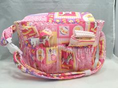 Doll size Diaper Bag in Pink Rocking Horses and Yellow Duckies with Pink and White Polka Dot Lining and all the goodies by GSRdolls on Etsy