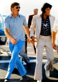 Elvis with Dick Grob (and his entourage) arriving in Hawaii 1973 for the Aloha from Hawaii Concert.