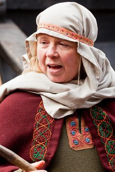Original description: Jorvik Viking Festival 2012 by alh1, via Flickr - I believe she is Saxon, no Viking but such a pretty costume. (My note: I love the embroidery on the cloak. The interwoven circles and the colors. It adds so much extra care and beauty.)