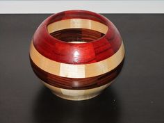 "Segmented wood bowl -- Woods used: Maple, Rosewood & Padauk -- Pieces of wood: 49 -- 3.5"" tall 5.5"" dia. #17"