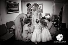 The bride getting ready with her loving helpers | Warren McCormack Photography