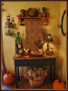 Too primitive for me, but I love the use of the shelf and quilt hanging above a table