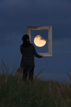 beautiful photos of a man and the moon