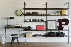 One of the more impressive DIY projects we've featured: a built-in desk made from plumbing pipes and wood shelving by Houston-based firm Analog/Dialog. Wall Shelving Units, Pipe Shelves, Wall Shelves, Shelving Ideas, Pipe Bookshelf, Bookcase Desk, Shelving Decor, Custom Shelving, Storage Shelving