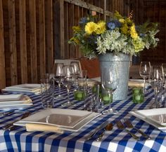 Wedding reception blue & white checked table setting at the West Monitor Barn - Richmond, VT - Vermont Wedding Dreams Fulfilled Here!