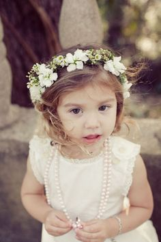 Flower girl crowns and long pearl necklaces