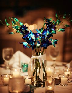 My wedding decor - blue dyed orchids and candles.