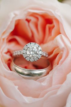 Vintage style setting with a round center diamond, with a diamond halo and matching band.