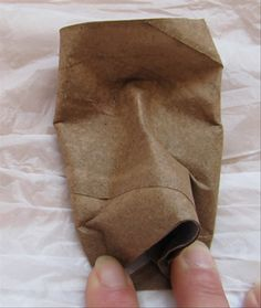 Push in the sides of the nose at the bottom and flatten an area the size of your finger on each side