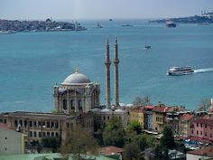 Ortakoy mosque and Asia-Europa side by Ciddi Biri - Bosphorus Asia and Europe side. Left side is Asia and right side is Europe. Far side middle of sea visible