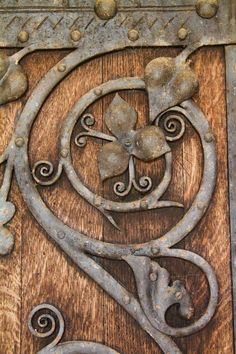 Photographs of door furniture at Winslow Church.  I was attracted by the colour and curves in the metal against the straight grain of the wood, and by the rich colours.