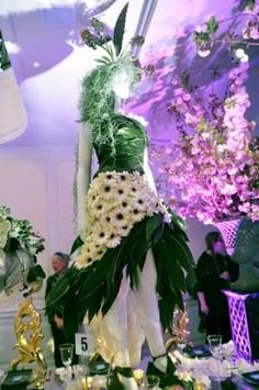 "Snapshots of the fashion-inspired centerpieces at the 2012 New York Flower Show Dinner Dance, reflecting this year's theme ""Couture en Fleur."""