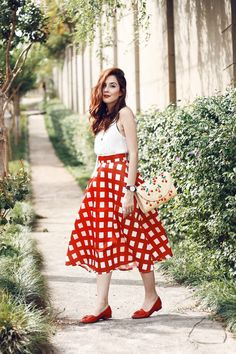 As a midi skirt lover I couldn't help wearing this gorgeous printed red gingham skirt. I wore it with a lace up top and flat shoes!