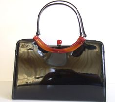 RESERVED Vintage Garay Mad Men Black Patent Leather Purse by TangerineStreet on Etsy https://www.etsy.com/listing/98189818/reserved-vintage-garay-mad-men-black