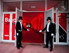 Decor- entryway options minus the men in tuxedo's  *utilize red lighting vs. red fabric draping