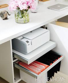 The upper pullout shelf holds the printer, which is, naturally, white. | Photographer:  Michael Graydon  Designer:  Sarah Hartill