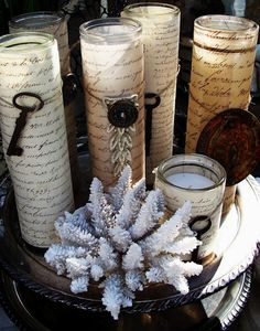 No real tutorial here.... But how 'bout this? Wrap tall votive candles in gorgeous papers or fabrics (music paper, ephemera, etc). Then embellish with some vintage treasures like keys, earrings, etc.! Gorgeous!