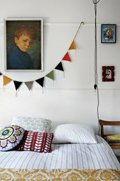 A Crying Boy print by Bragolin hangs in the main bedroom, while the bunting came from Melbourne's Magnolia Square craft market, as did the round cushion. Country Style, photography Sharyn Cairns.