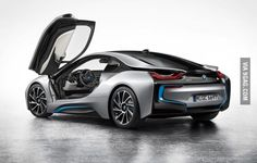 This is a BMW I8. It looks like it's trying to sh*t out a silver porsche 911.