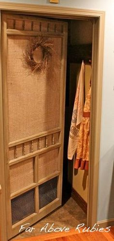 An old screen door from her grandparents' home was repurposed with chicken wire and burlap and is now her laundry room door!