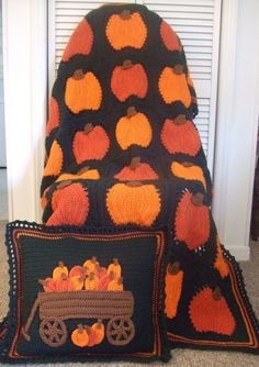 Pumpkins galore afghan and matching pillow; pattern available for purchase.