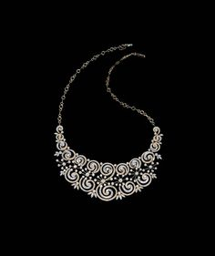 Inspired by the spirals of unknown galaxies, this statement neckpiece, from Tanishq's new Inara bridal collection, is studded with diamonds set in yellow and white gold.