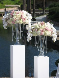 Bountiful ceremony arrangements with hanging strands of crystals. Posh Peony Floral and Event Design.