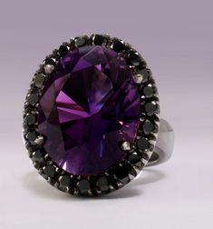 The ring is made of black diamonds and an amethyst. The contemporary jewels were handmade and took about 3 weeks to manufacture.This lovely set is now on display in Mark Gold's store in Durban. And though it was only a loan to the princess, it's not for sale.