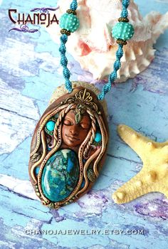 Ocean Goddess Pendant-Mermaid necklace goddess jewelry by Chanoja on Etsy. Her long copper hair give her a wonderful mermaid look. She wears beautiful dyed howlite and raw neon blue apatite gemstone earrings and has her eyes closed in meditation. She features many intricate details, lots of different gemstones and a georgous chrysocolla crystal as the focal bead. The tiny lovingly handcrafted leaves and the many gemstones like crystal quartz, pyrite and dyed blue howlite pieces make her a…