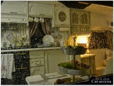 Glamping, view through a rainy trailer window into the sweet cottage whites and grain sacks trailer of: Cat-arzyna