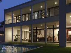 The Crystal Contemporary Exterior by Home Builders in Tampa FLorida Alvarez Homes (813) 701-3299. Windows instead of walls...Spectacular!  http://www.alvarezhomes.com/tampa-home-builders-portfolio-of-homes/the-crystal