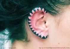 geometric triangle ear tattoo