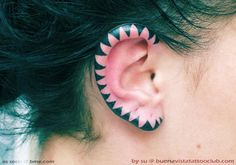geometric triangle ear tattoo - cool placement for a pair's larks